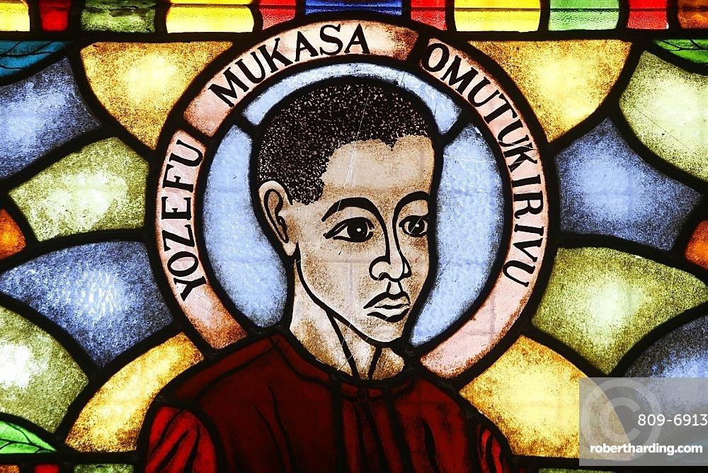 Stained glass in church of martyr, Namugongo Catholic Martyrs' Shrine, Kampala, Uganda, Africa