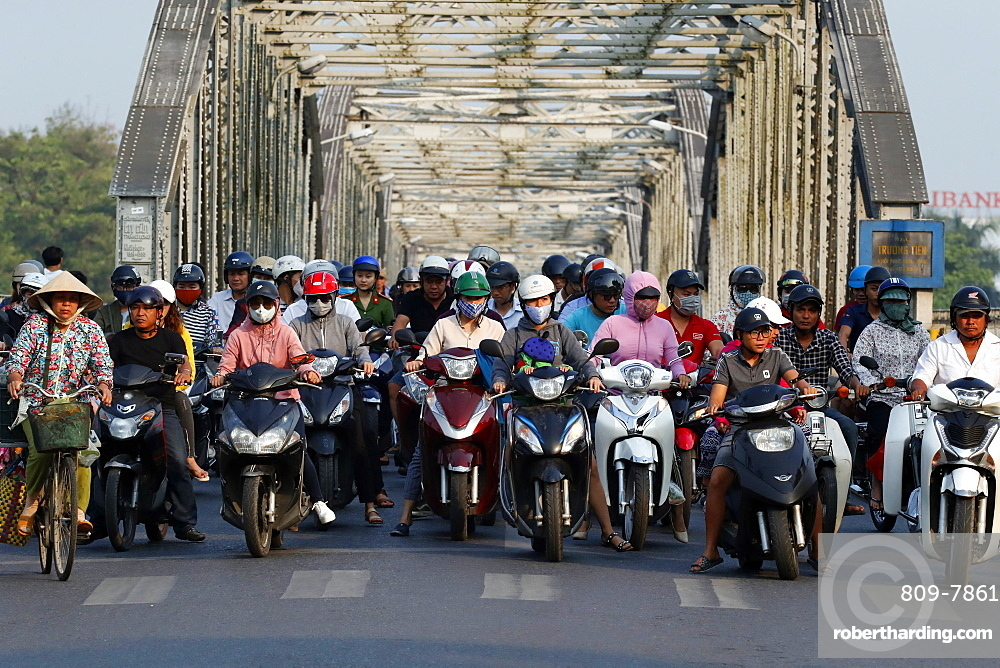 Scooters crossing the famous Trang Tien bridge in morning rush hour traffic, Hue, Vietnam, Indochina, Southeast Asia, Asia