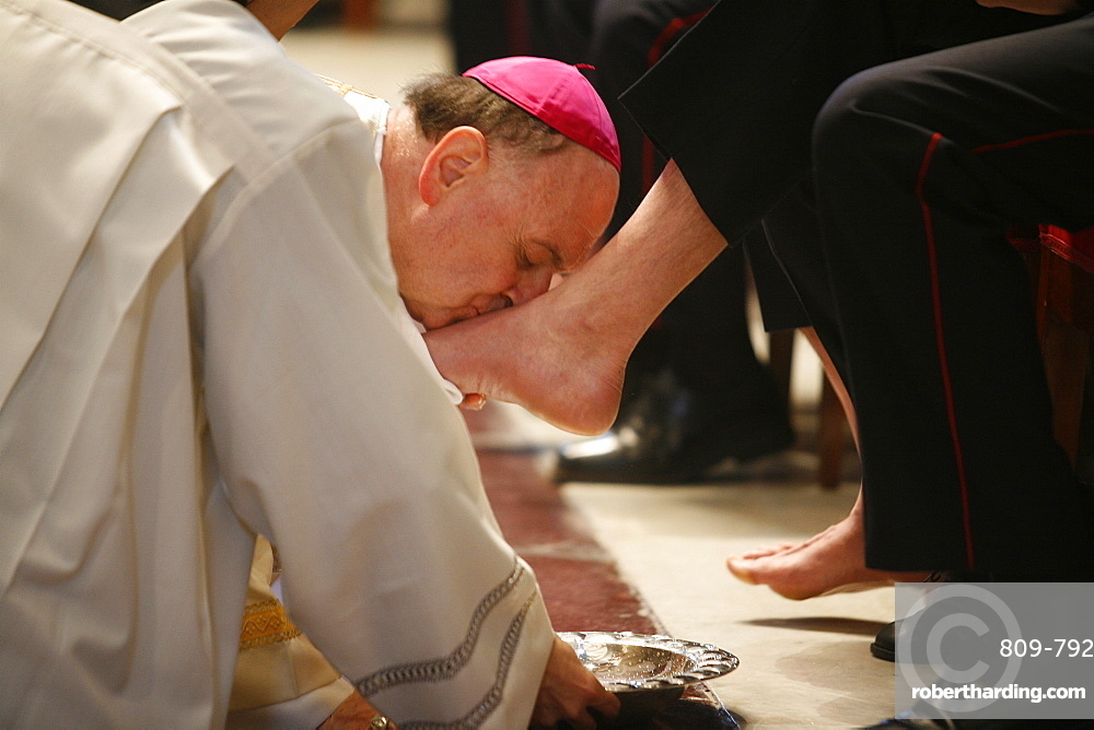 Bishop kissing feet after washing them, Easter Thursday Mass in St. Peter's Basilica, Vatican, Rome, Lazio, Italy, Europe