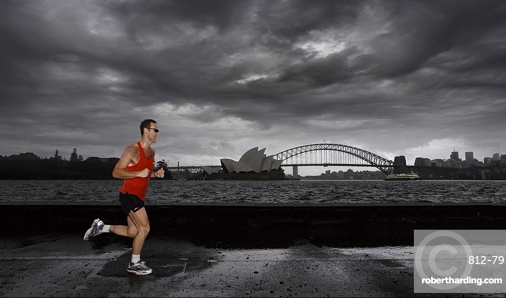 Man jogging in front of Sydney harbour, Sydney, New South Wales, Australia, Pacific