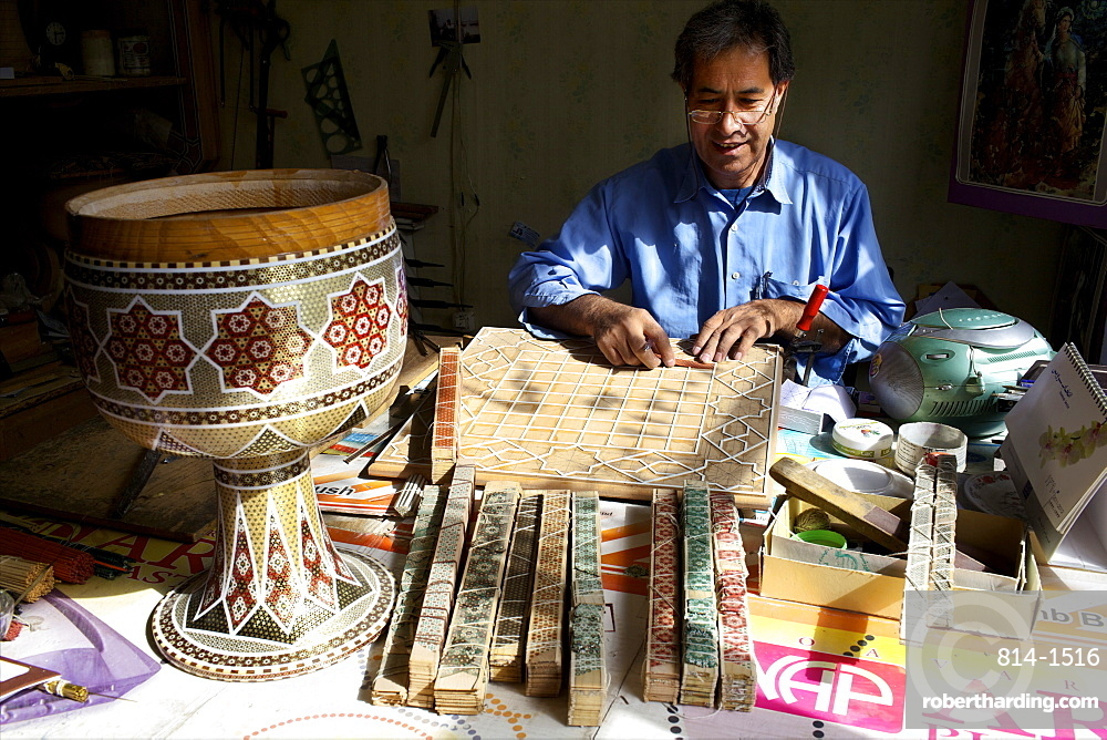 A marquetry worker in the bazaar of Isfahan, Iran, Middle East