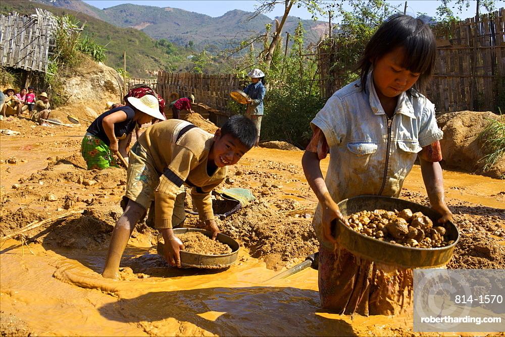 Boys searching for ruby stones in Mogok mining sites, Myanmar (Burma), Asia