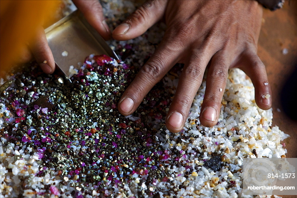 After bashing the sand, the ruby stones concentrate naturally in the middle of the container, Mogok, Myanmar (Burma), Asia
