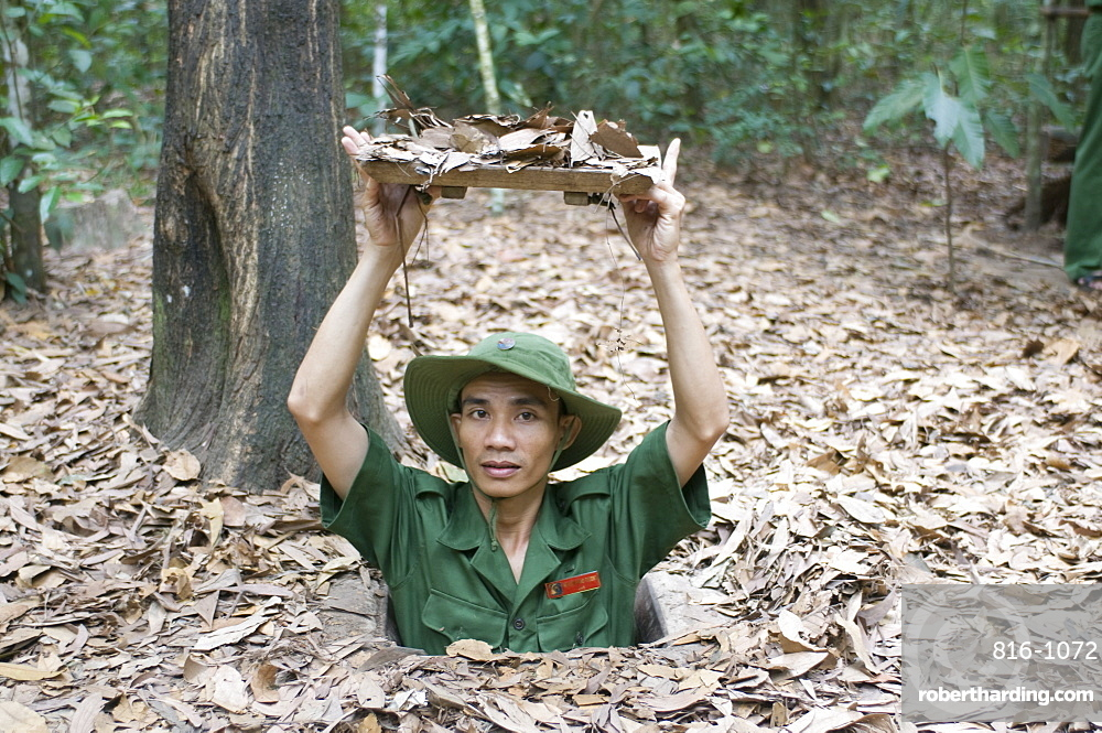Soldier showing the entrance to the former Viet Cong tunnels of ChuChi, near Saigon, Vietnam, Indochina, Southeast Asia, Asia