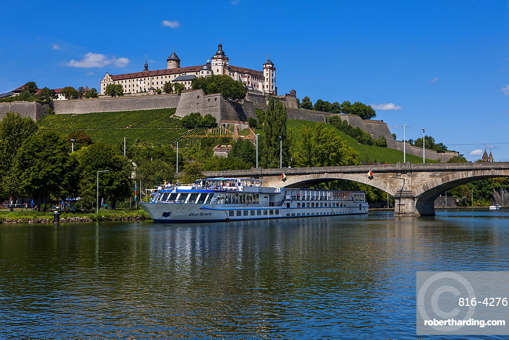 Cruise ship on the Main valley in Wurzburg, beyond Fortress Marienberg, Franconia, Bavaria, Germany, Europe