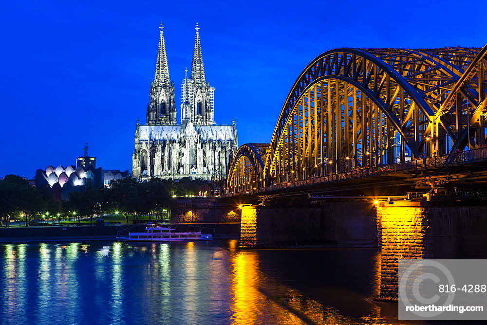 Rhine bridge and Cathedral of Cologne above the River Rhine at night, Cologne, North Rhine-Westphalia, Germany, Europe