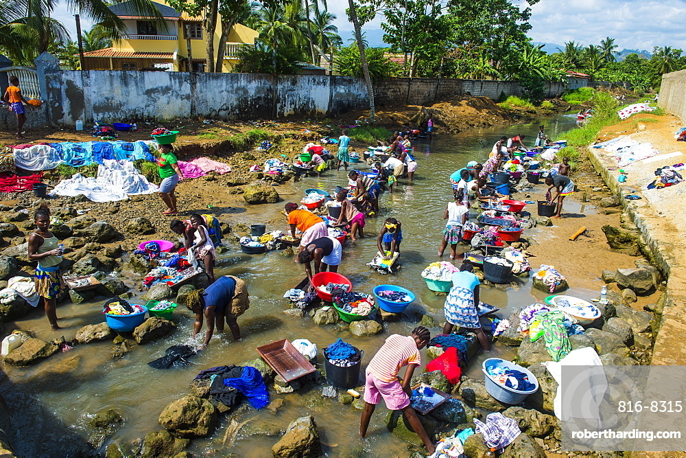 Women washing clothes in a river bed, City of Sao Tome, Sao Tome and Principe, Atlantic Ocean, Africa