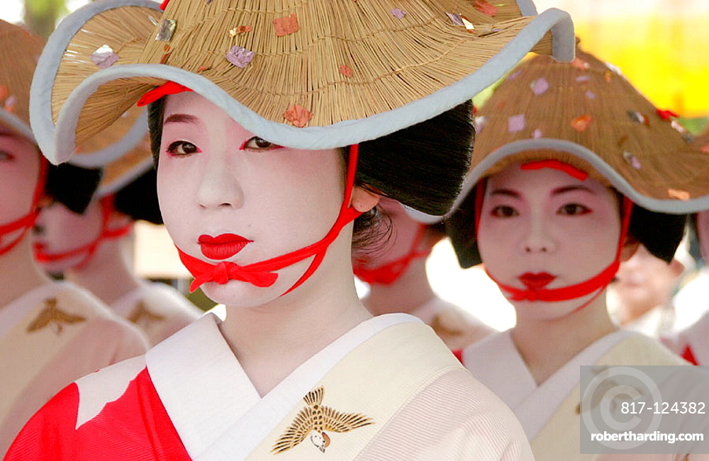 Women in traditional costume at Hanagasa Junko (procession of floral bonnets) during Gion Matsuri traditional Japanese festival, Kyoto, Japan
