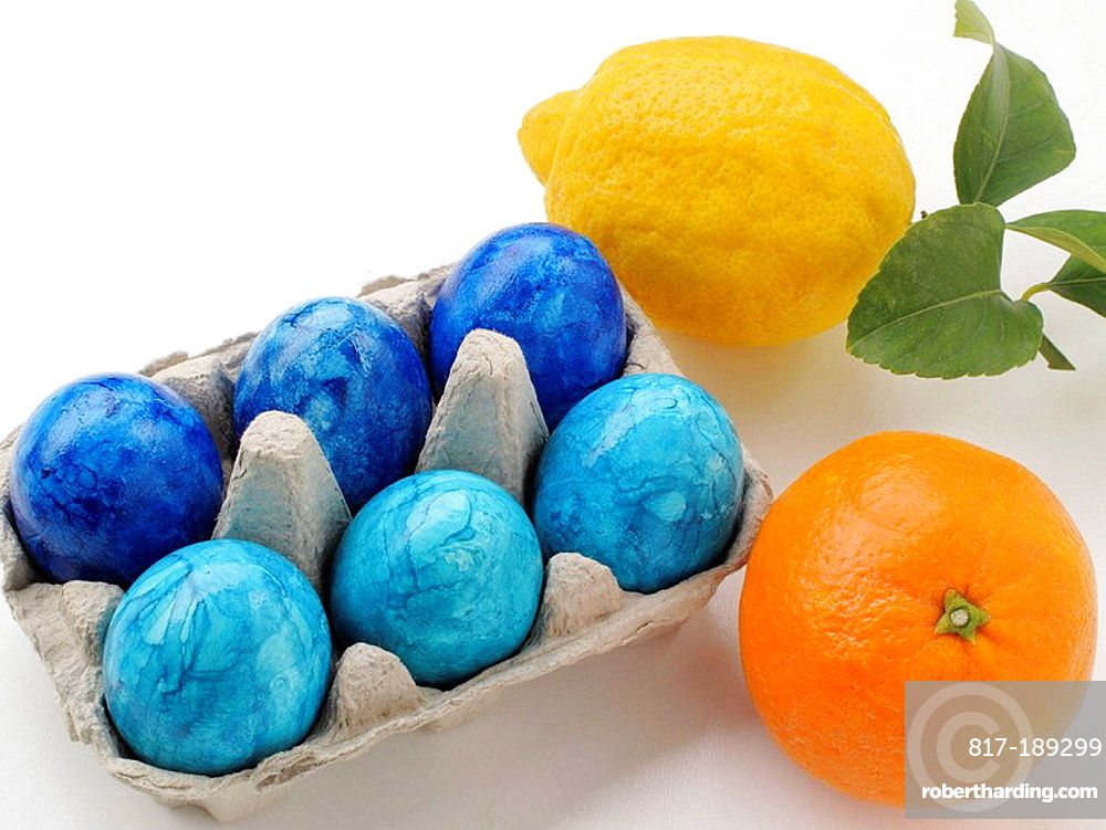 Easter eggs colored with orange and lemon