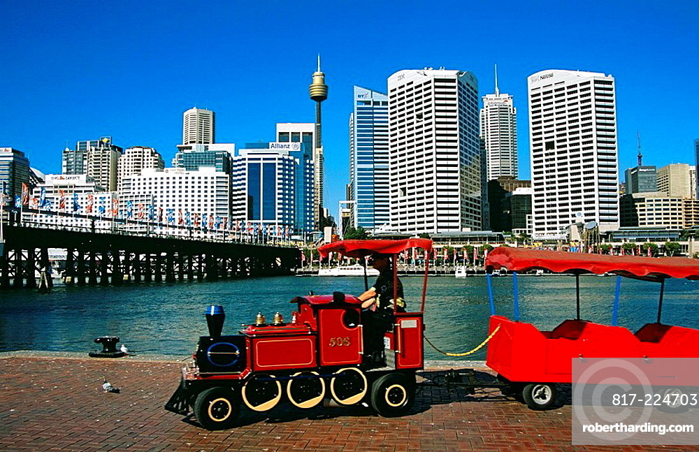 Darling Harbour, red tourists transportation vehicle, and Pyrmont Bridge, Sydney, New South Wales, Australia