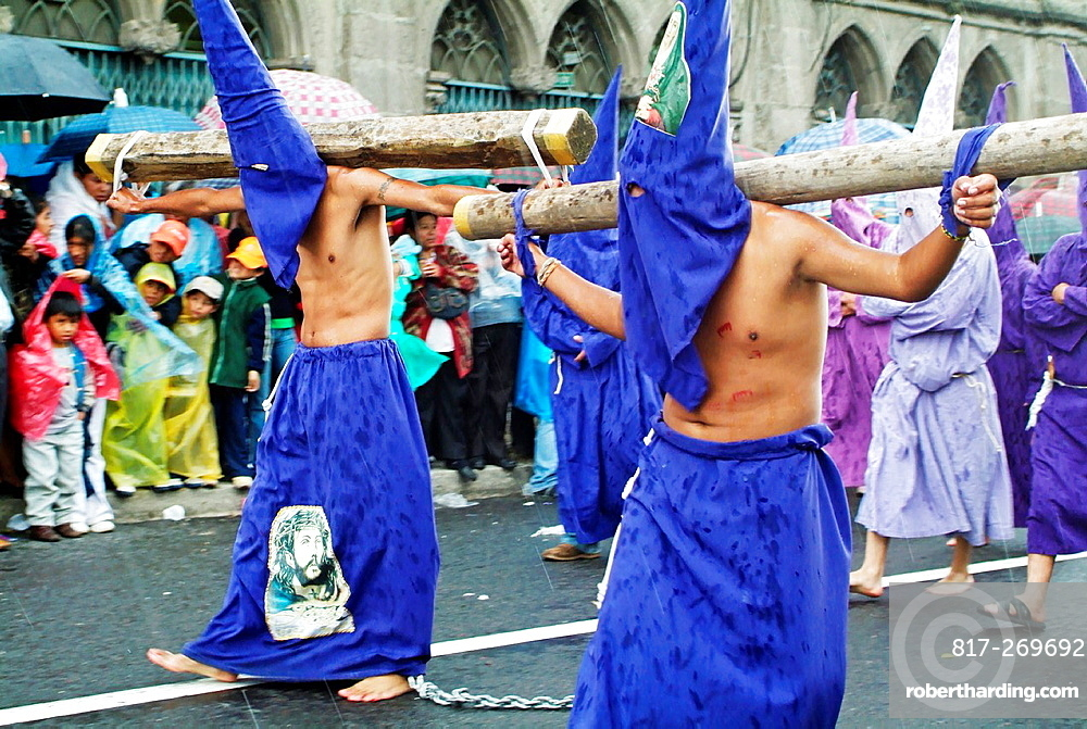 Hooded men at Easter procession in Quito, Ecuador