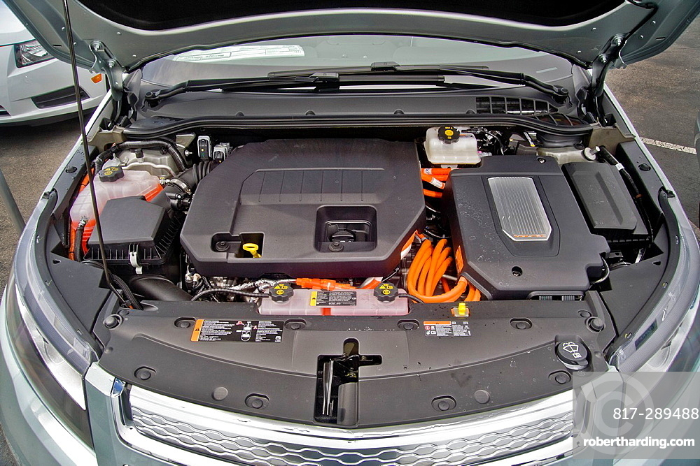 The engine compartment of a Chevrolet Volt hybrid gas/electric car Right side: the power inverter in top of the electric motor Left side: the 1 4-liter gasoline-powered engine used as generator to provide power to the electric motor or to engage mechani. The engine compartment of a Chevrolet Volt hybrid gas/electric car Right side: the power inverter in top of the electric motor Left side: the 1 4-liter gasoline-powered engine used as generator to provide power to the electric motor or to engage mechanically to assist propulsion when the battery is depleted It is the most fuel-efficient car with an internal combustion engine sold in the United States and can travel 25 to 50 miles on a lithium-ion battery with a total range of 379 miles Overall fuel economy is 60 miles per gallon