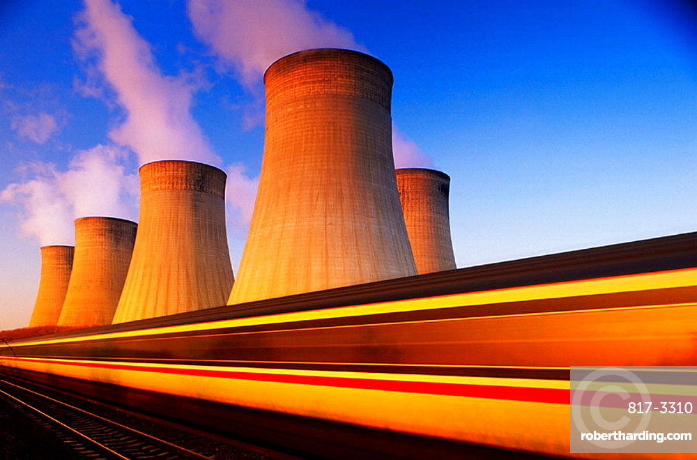 Train at speed, Coal-fired power station, Nottinghamshire, England