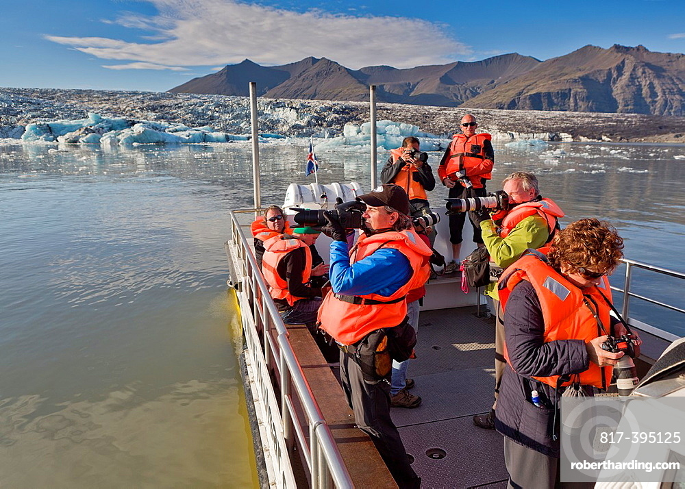 Photographers on boat tour of the Jokulsarlon Glacial Lagoon, Iceland