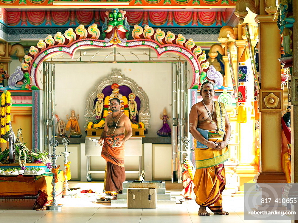 The Chief Priest praying and performing holy rituals inside a Hindu Temple in Malaysia