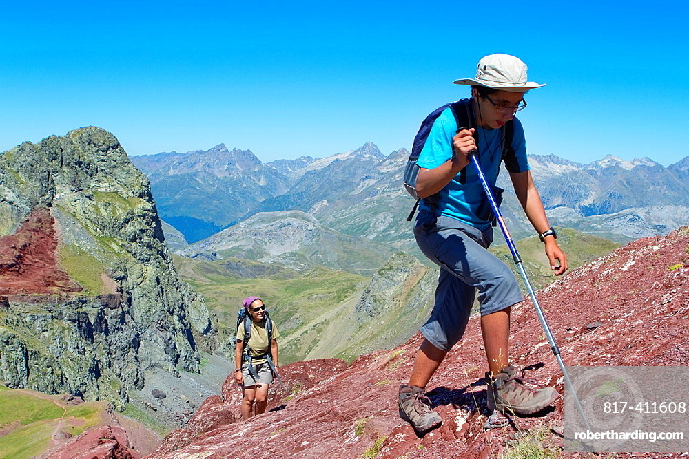 Hikers walking to summit of Anayet, an old volcano in Tena valley Formigal Sallent de Gallego Pyrenees Huesca province Aragon Spain