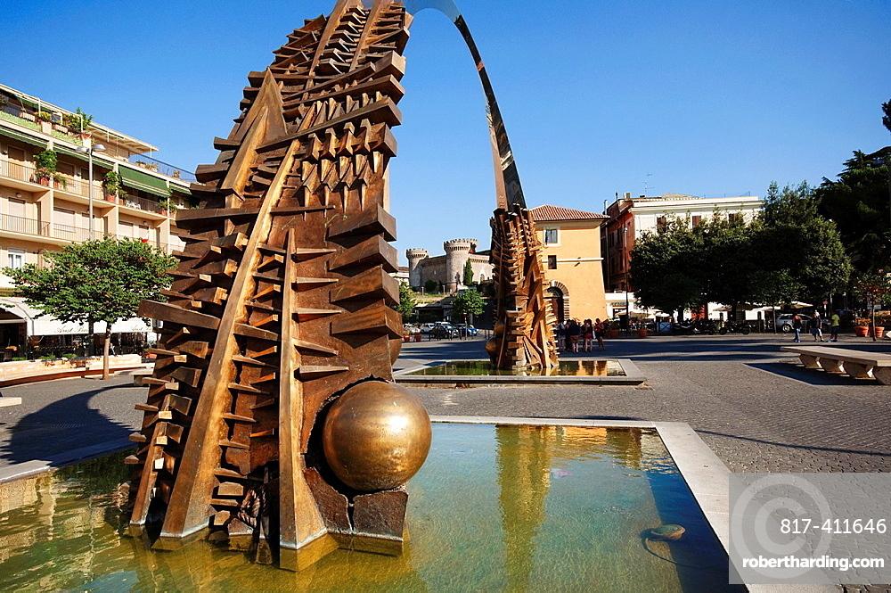 Italy, Lazio, Tivoli Giuseppe Garibaldi Square, Arch Fountain by Arnaldo Pomodoro background the Castle of Rocca Pia