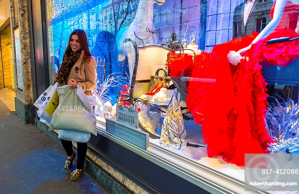 Paris, France, Woman Holding Shopping Bags, at French Department Store Printemps, Dior Shop with Christmas Decorations, Window Display at Night