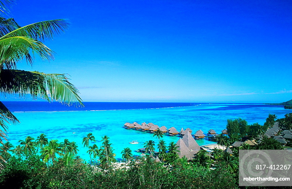 Ocean and huts over water in beautiful Tahiti in Bora Bora French Polynesia in the South Pacific on holiday
