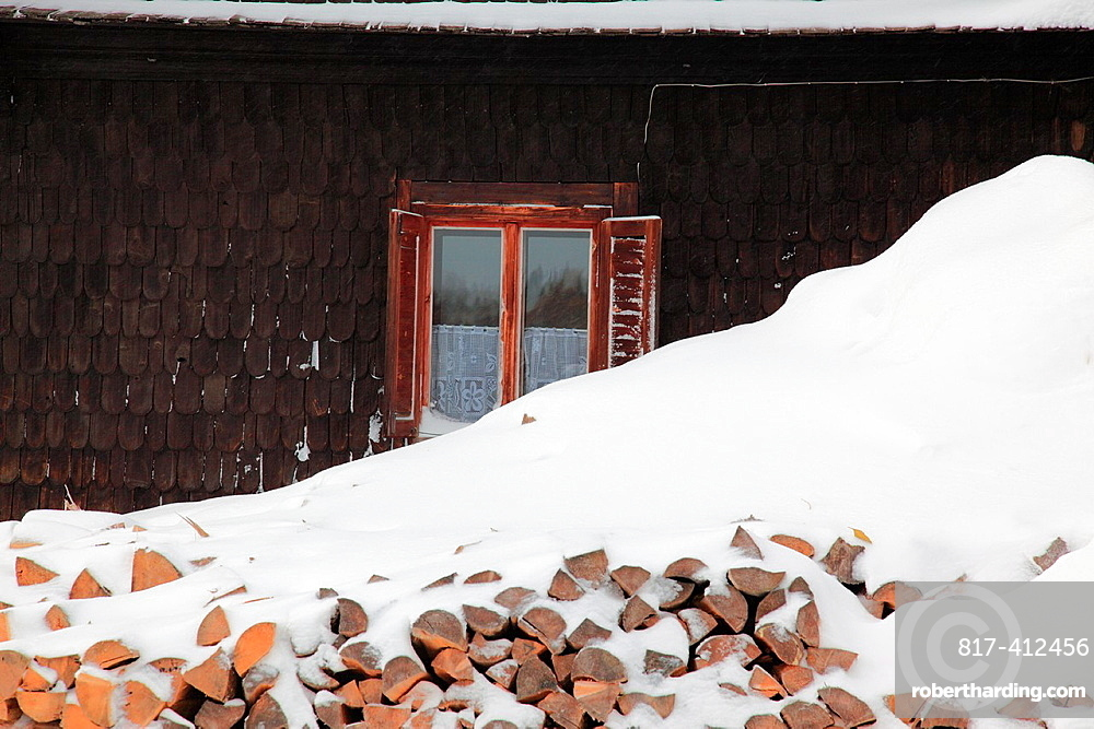 Stack of firewood in front of old historic building in winter at the village Prasily, German: Stubenbach, near Susice, Okres Klatovy, Bohemia, Czech Republic, Europe