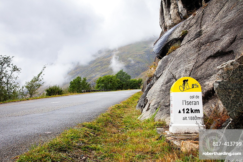 Cycling route sign showing distance and gradient on the road up the Col de LÂ¥Iseran, Savoie, France
