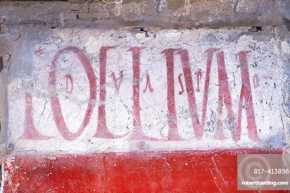 Graffitti on buildings along the Via del Abbondante, Pompeii