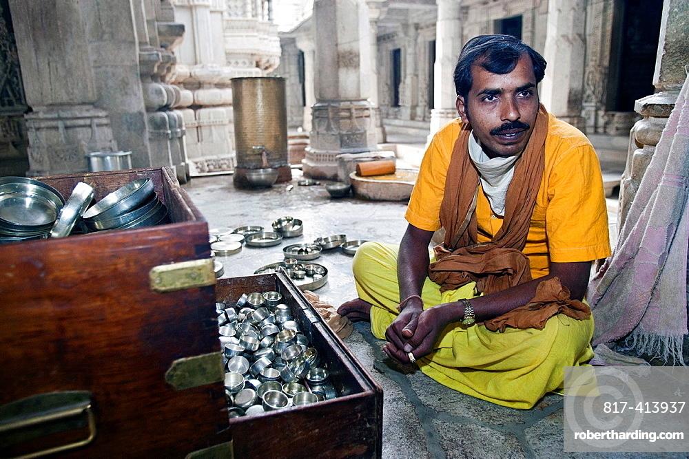 Priest in saffron robes Jain Temple Ranakpur Rajasthan India