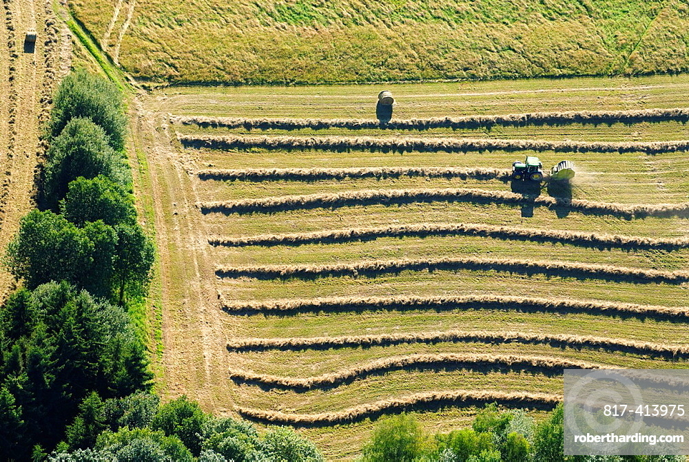 Aerial view of tractor in harvest, East of Moselle, Lorraine, France