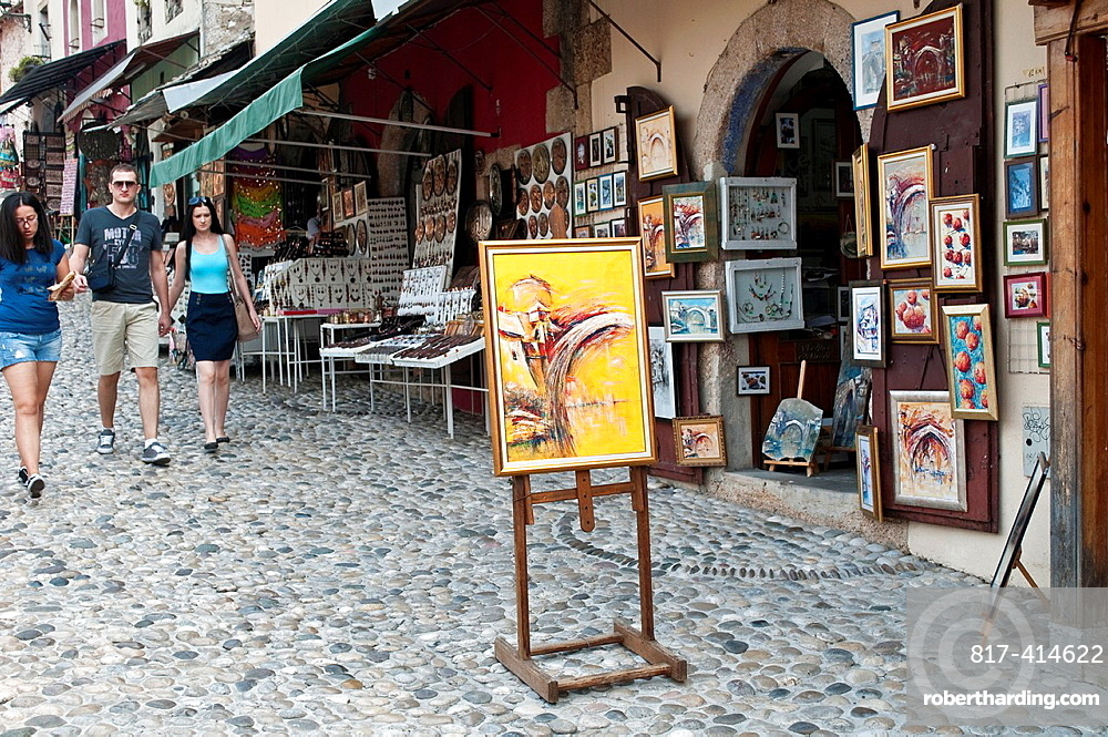 Paintings on sale in a street in Old Town, Mostar, Bosnia and Herzegovina