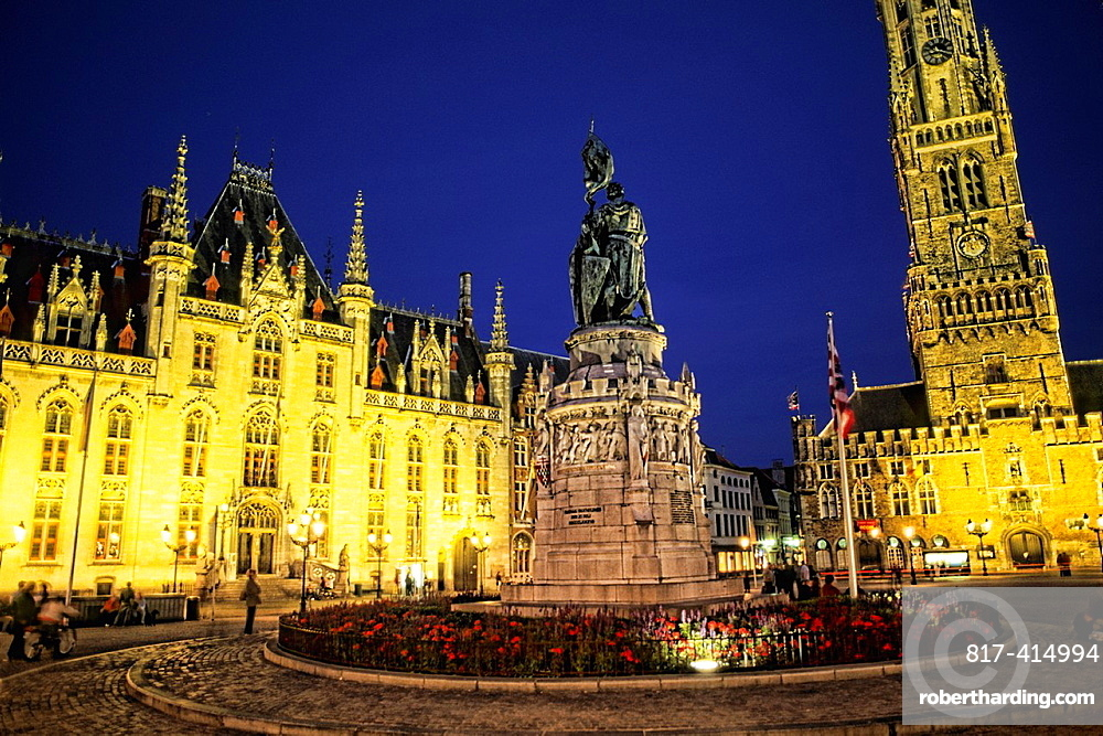 Belgium night photo of House of Governor and Belfort Church in Marketplace in downtown Bruges Belgium