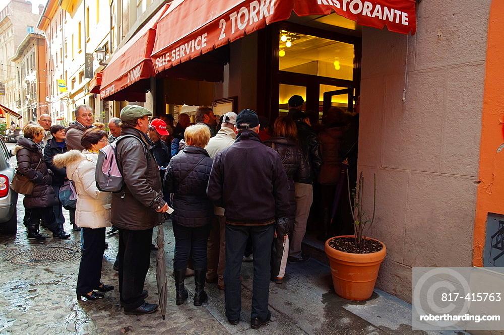 People waiting to get into 2 Torri self service restaurant Quadrilatero central Bologna city Emilia-Romagna region northern Italy Europe