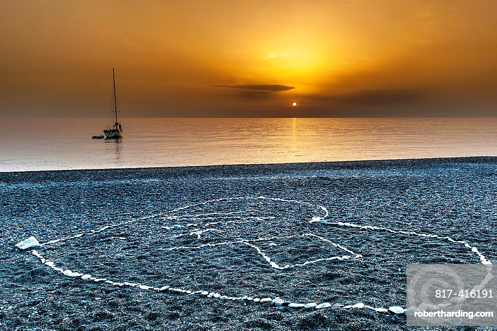 Europe, France, Haute Corse 2B, Cap Corse Nonza Drawing rollers Sunset
