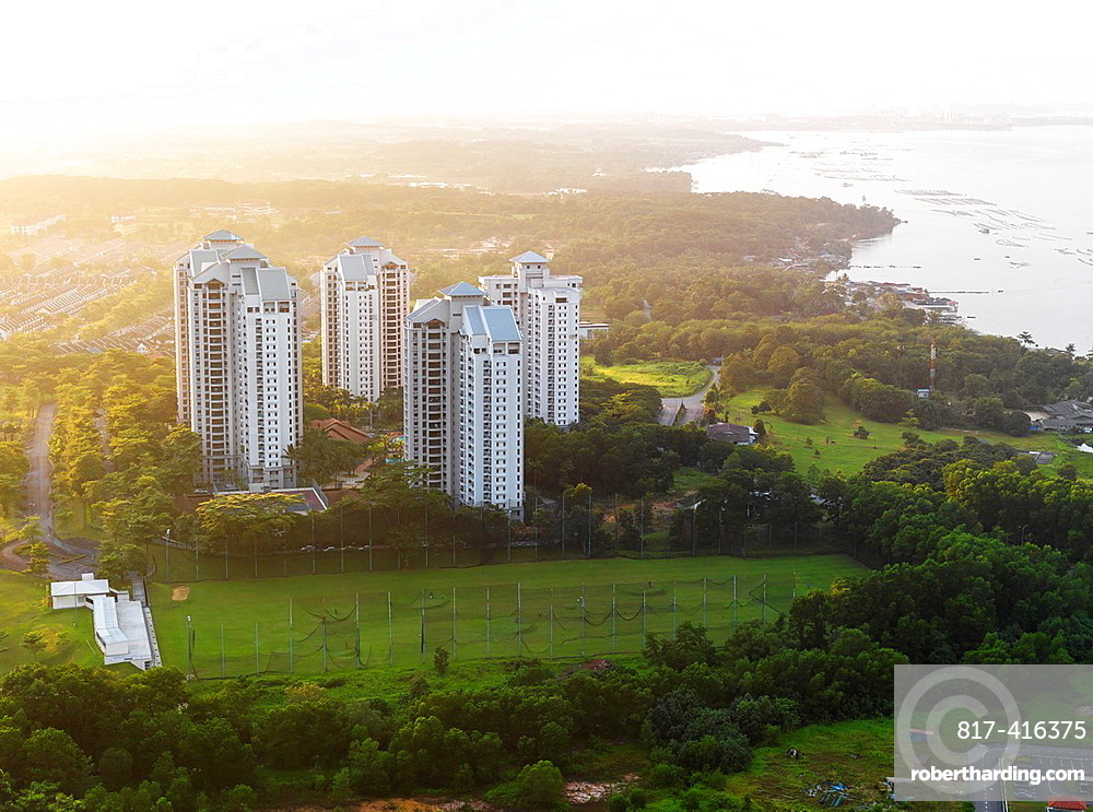 Aerial view of high rise residential complexes at sunset