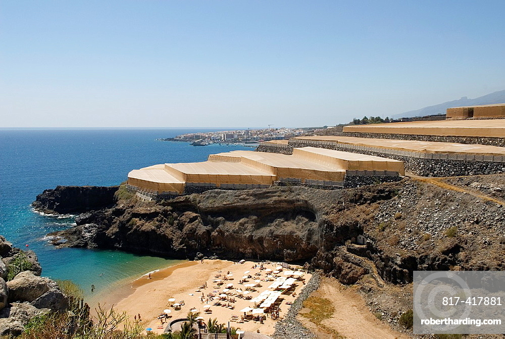 Beach of the Abama hotel with agricultural greenhouse background at Guia de Isora, Southwest of Tenerife, Canary Islands, Atlantic Ocean