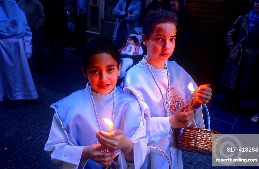 Penitents  Resurrection Sunday  In calle Mesones  Brotherhood`Resucitado de Regina¥  Granada  Andalusia, Spain