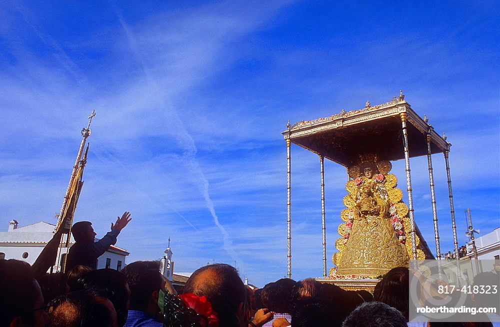 priest screaming wishes and thanks to the virgin,Romeria, pilgrimage, at El Rocio, Blanca Paloma, virgin procession, Almonte, Huelva province, Spain