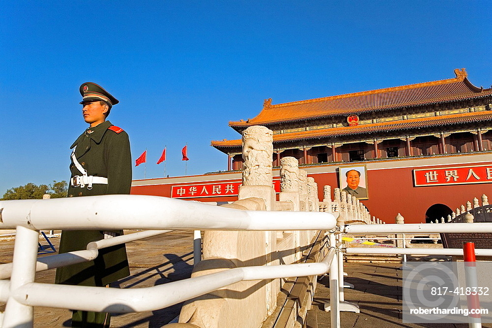 Guard in Gate of Heavenly Peace with Portrait of Mao Ze Dong ,in Tiananmen Square,Beijing, China