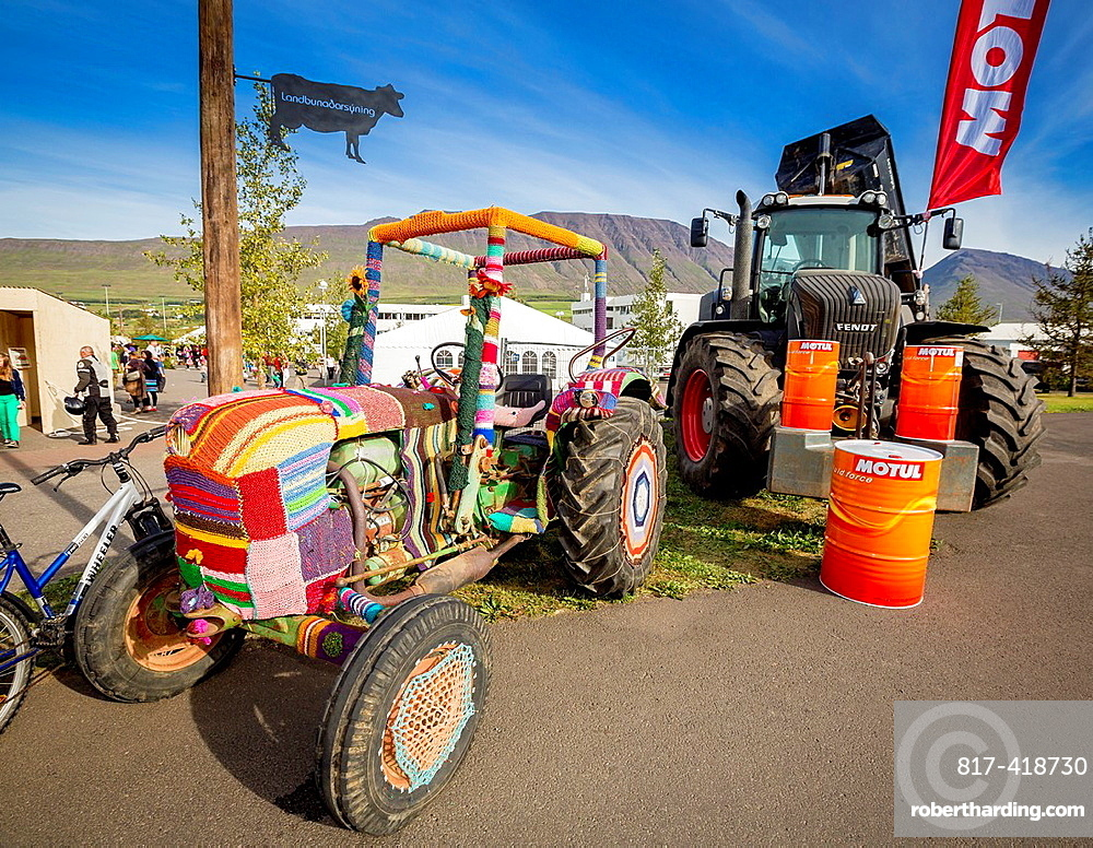 Old tractor with handcrafted decorations, Eyjafjordur, Iceland  People decorate with handcrafted works during summer festivals