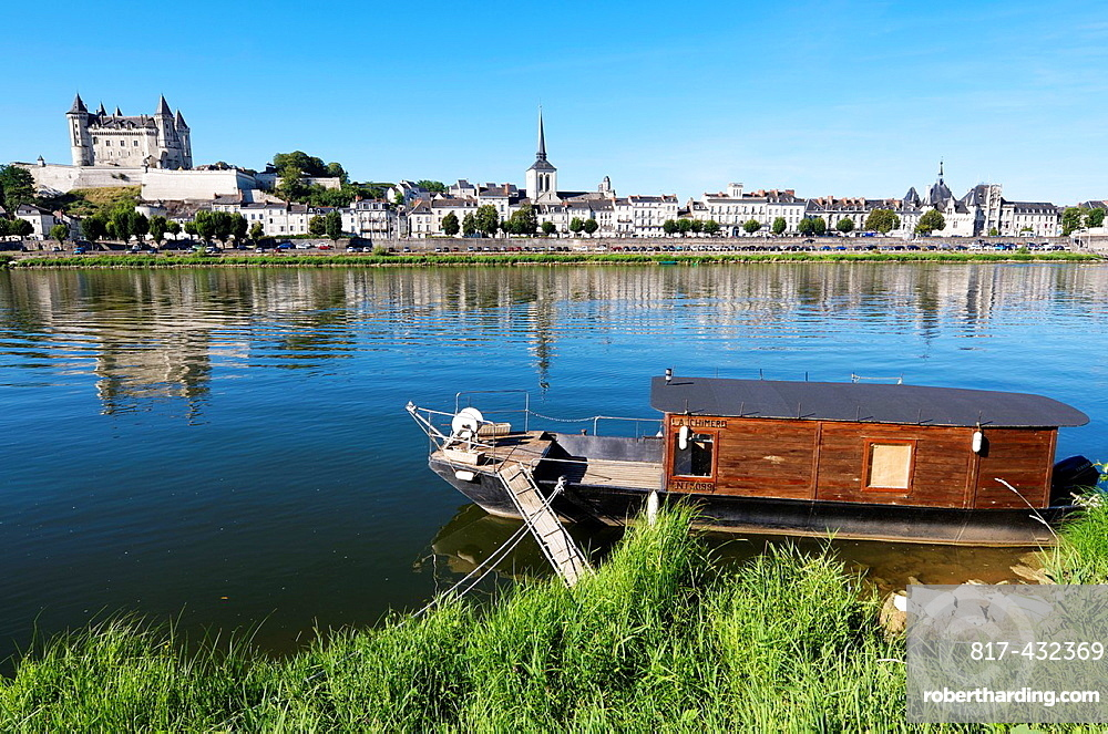 Boat on the River Loire in the town of Saumur, you can see the famous castle, Loire Valley, France