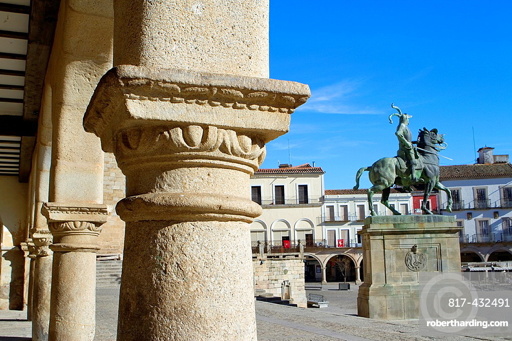 Typical arcade and equestrian statue of Francisco Pizarro in Main Square of Trujillo Caceres Extremadura Spain