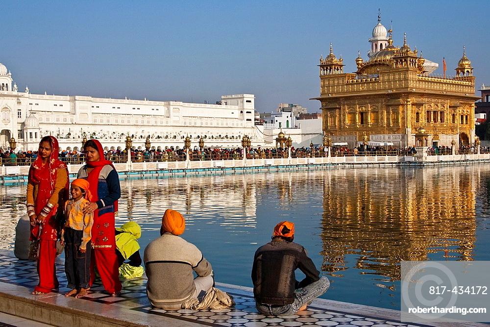 Sikh Pilgrims, The Golden Temple of Amritsar, aka The Harmandir Sahib or Hari Mandir Punjab, India