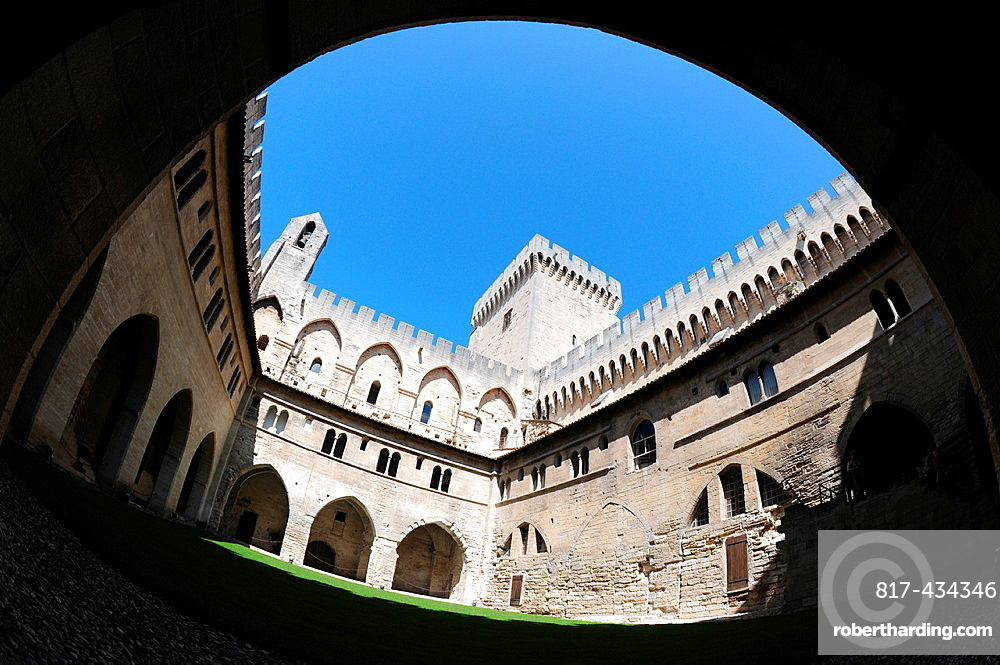 Courtyard of gothic style Palais des Papes Papal Palace or Palace of the Popes in Avignon city, Provence region in France