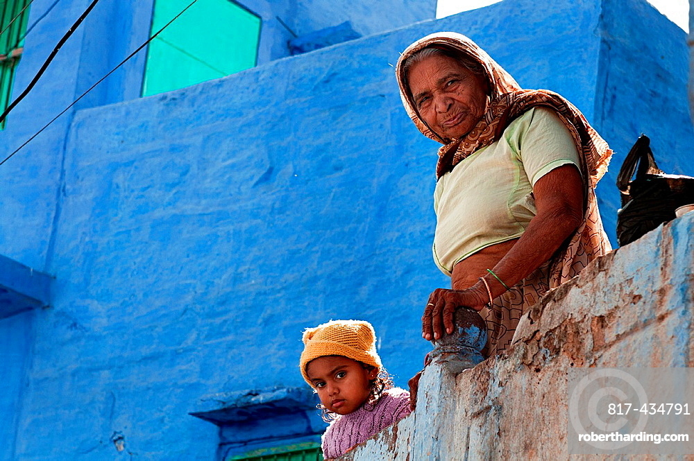 Woman and child in a balcony. Jodhpur, Rajasthan, India