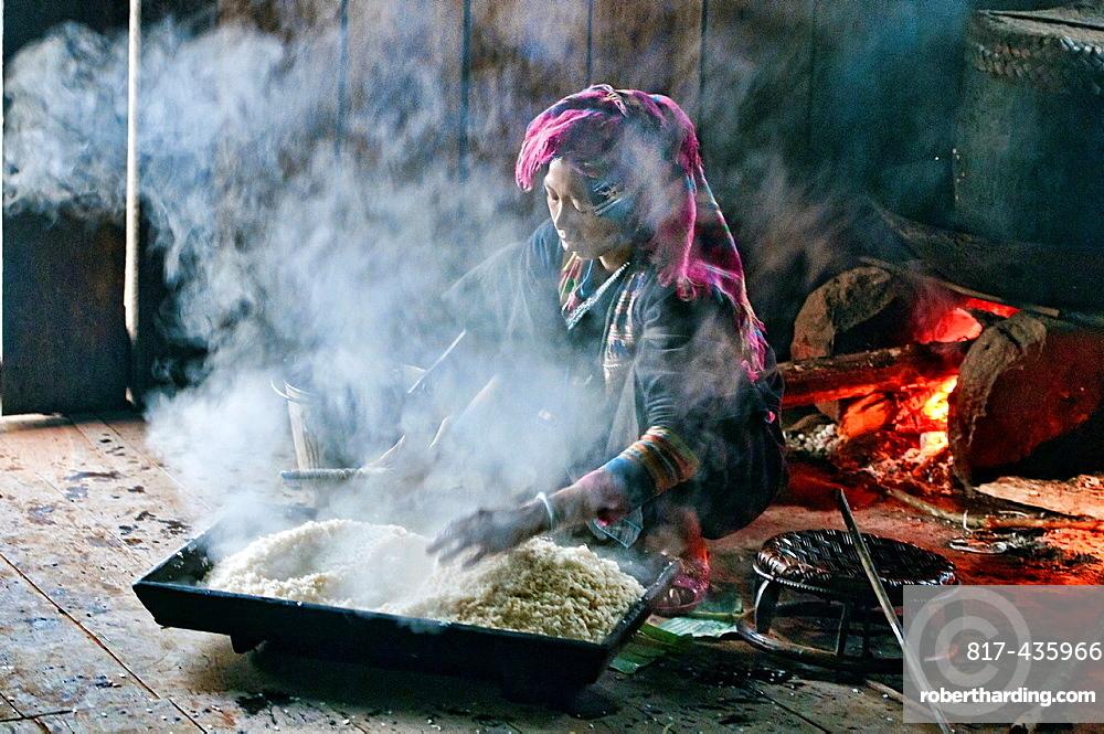 Akha woman preparing rice, Phongsaly, Laos