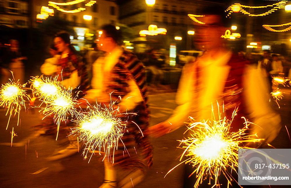 Flower offering,Fire works tribute to `Virgen de los desamparados', Fallas festival,San Vicente Martir street,Valencia,Spain