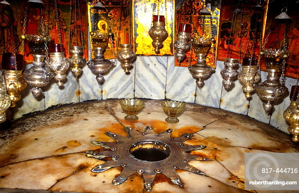 silver star marking the place were Jesus was born according to christian belief in church in Bethlehem, Israel