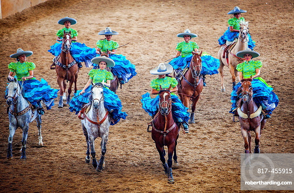 Escaramuzas ride their horses. A charreada Mexican rodeo at the Lienzo Charro Zermeno, Guadalajara, Jalisco, Mexico.