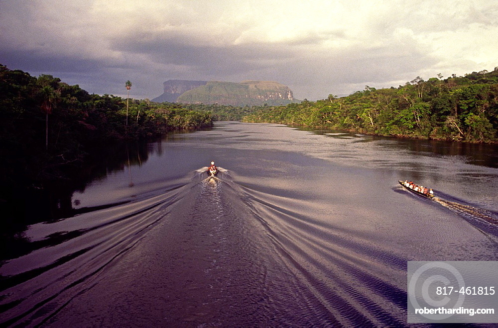 Aerial view of tourist boats going up Carrao river showing tepuis in the bakground. Canaima National Park, Bolivar State, Southern Venezuela.