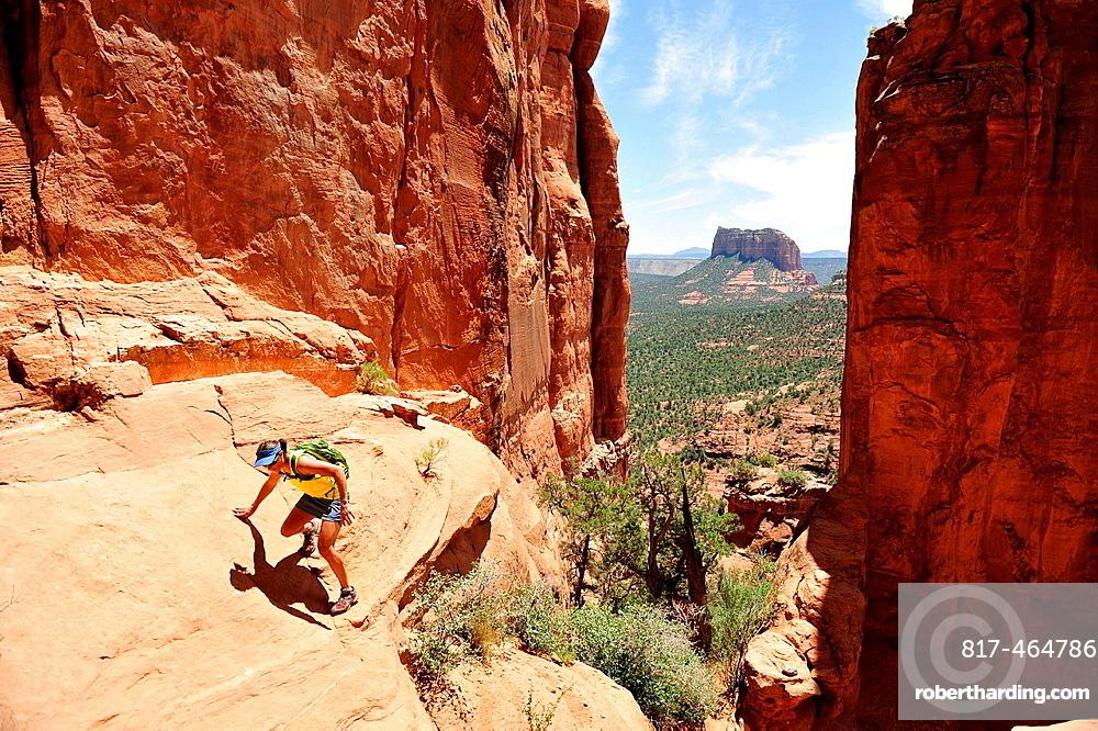 Female hiking rock formation in Sedona, Arizona, USA