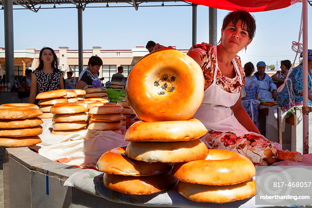 Woman selling non bread, Siyob Market, also known as Siab Market, Samarkand, Uzbekistan.
